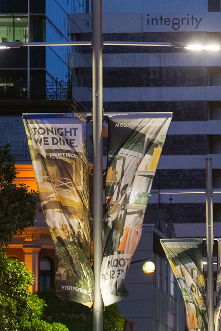 Twin white banners on MFP at night