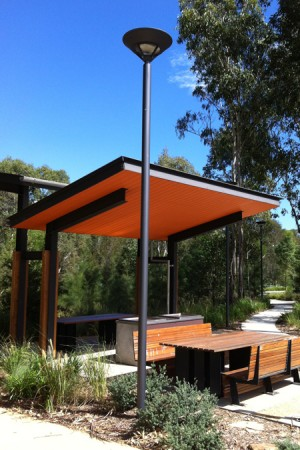 Park pole in front of timber shelter and seating